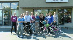 (L to R) Scott, Bjarne, Christian, John, Garrick, Kalonica, Mike, Lori, Jason, Jess, and Joe fill the empty parking spaces in front of StarFish and ViVitro on Day 1.
