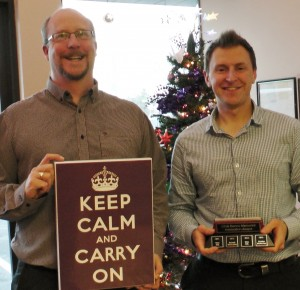 John and Christian display their awards in front of the 2014 StarFish Christmas tree.